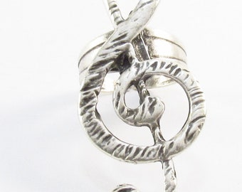 Treble Clef motif silver plated adjustable ring.