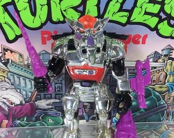 Vintage 1993 Robotic Chrome Rocksteady TMNT Teenage Mutant Ninja Turtles action figure with weapons 100% COMPLETE RARE!