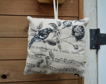 music cushion, bird and flowers