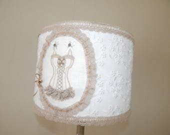 Shabby style lamp with its feminine embroidery