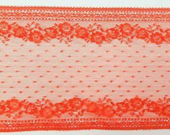 Orange, embroidered floral lace on tulle. Two embroidered edges. (ref 946 23 56)