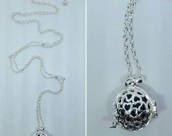 Pregnancy's Bola cage clover with pearls and star clasp