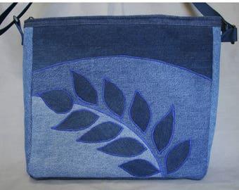 Large denim shoulder or crossbody bag, 5 interior pockets, zipper closure, sturdy matching web straps, lightweight, laptop/tablet/music bag
