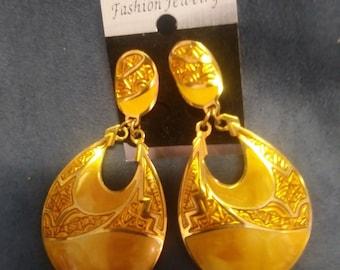 Gold clip dangle earrings