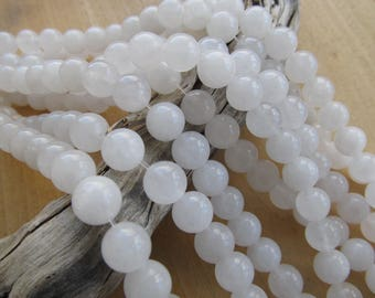 Set of 10 beads 10 mm diameter genuine white jade: natural.