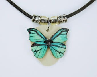 Necklace Butterfly turquoise - blue on a black leather strap unique - Kunstelder in beige Butterfly spring jewellery wood button