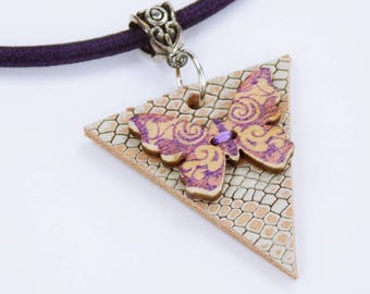 Necklace butterfly in violet-purple on dark purple silk ribbon on triangular leather piece with snake skin embossing in pink-beige