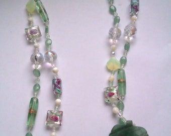 Jade leaf pendant long glass bead necklace