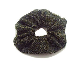 Pet hair fabric Houndstooth black and green.