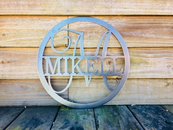 qty.1- 15 inch monogrammed sign and qty. 1- 20 inch sign