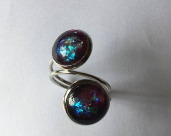 Two blue cabochons with medium silver glitter ring