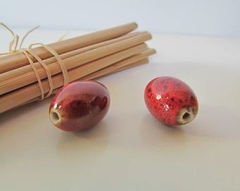 2 red ceramic beads 18 x 13 mm - hole 1.5 mm - 521.7