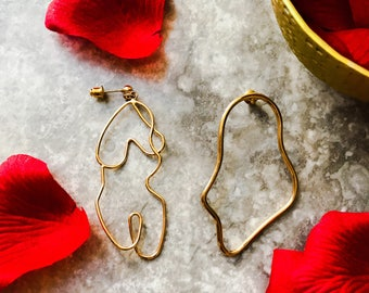 Face earrings, body art earrings. art earings. wire art earings, Nude body earings , gold color earings,