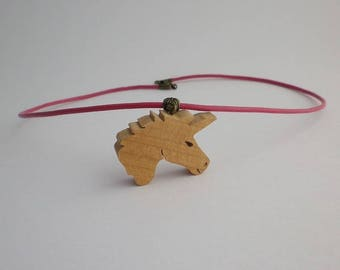 Pink Unicorn in cherry wood and leather pendant