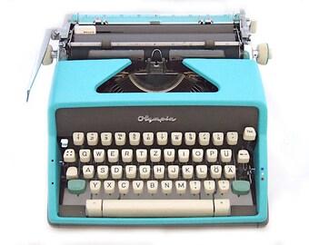 Olympia SM7 typewriter, 1963, blue typewriter, vintage typewriter, working typewriter, portable typewriter, Olympia typewriter, qwertz.