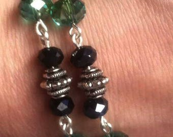 Double stranded bracelet with Rondelle beads and a Buddha charm, Teal, navy blue and silver