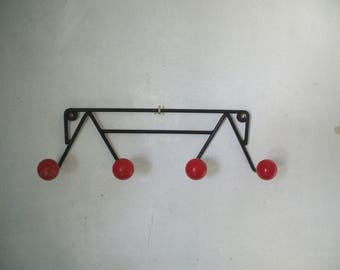 Red balls, four coat hooks coat hangers.