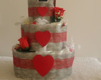 beautiful red and white diaper cake