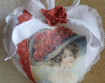 Heart hanging in white linen and antique Victorian style lace