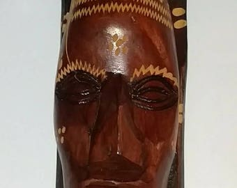 A vintage hand carved Tiki statue made in Jamaica.