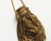 Vintage & Retro Handbags, Purses, Wallets, Bags 1940s Vintage Whiting and Davis gold metal mesh Beggars Bag Accordion cap purse  Evening bag $55.00 AT vintagedancer.com