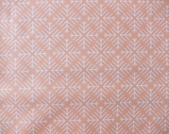 Printed graphic coral and white cotton fabric, pattern stars, snowflakes.