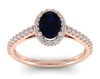 14K Rose Gold 1 1/3 CT Oval Sapphire and Diamond Halo Ring
