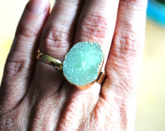 Adjustable green stone ring