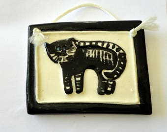 ceramic plate decorated with a tabby cat relief - wall decor