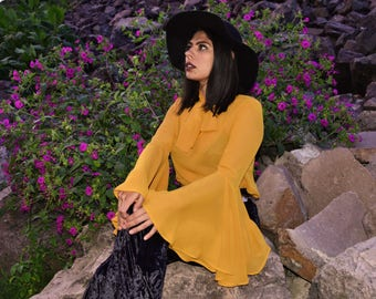 Mellow yellow blouse. 60s, 70s style blouse with bell sleeves and bow tie.