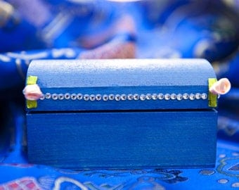 Adorned with flowers and bright wooden blue box