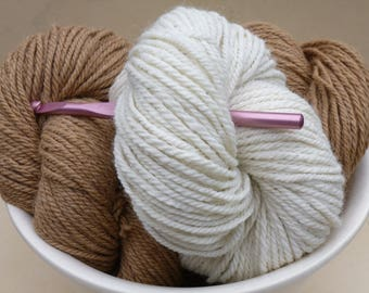 100% Alpaca Yarn, 3 ply worsted weight, 150 yards/skein (about 4.5 oz), in 2 natural (undyed) colors: Golden Fawn and Creamy White
