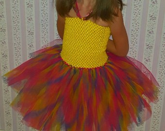 sale 25 instead of 30.Robe 2 to 5 years with strapless yellow Rainbow tutu