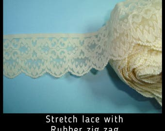 Cream Stretch Lace 44mm wide with zigzag rubber on back.