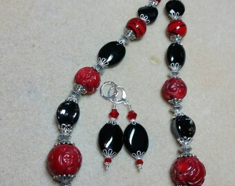 Striking black and red necklace and earrings.