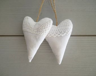 Hearts worn white fabric and lace pillow
