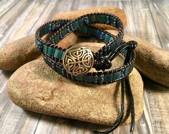 Bohemian Ladder wrap bracelet with Tila & Seed beads in Blue, Green and hints of Gold and with Brass Celtic Button Closure