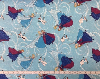 Disney's Frozen -Sister's Elsa and Anna Skating on Blue Ice with Olaf on Glittered Cotton Quilting Fabric