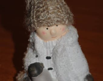 Christmas decoration: child in winter