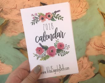 2018 desktop calendar with hand lettered Scripture and floral designs in wooden block