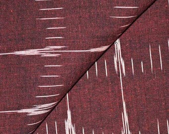 10% Off On Maroon and White Ikat Fabric