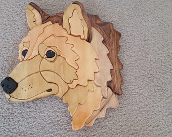 Wildlife Wolf head wall handing. Intarsia project made with solid pine wood. Shades of brown, with black eyes and nose