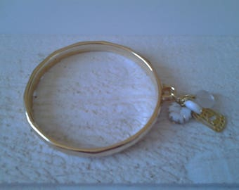Gold plated Bangle Bracelet has white charms