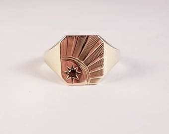 Vintage sunburst garnet ring in yellow gold