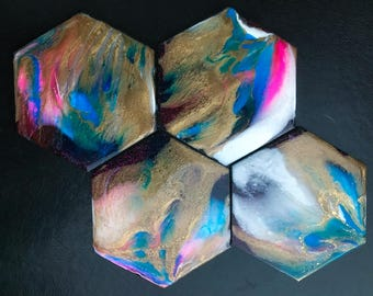 """Set of four hexagonal coasters with bright acrylic colors, shimmering gold and a glossy resin finish 