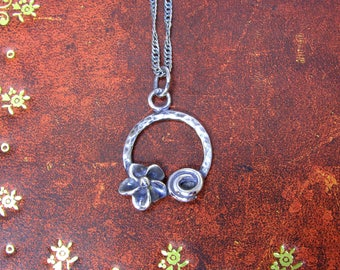 Handmade silver pendant with flower and swirl