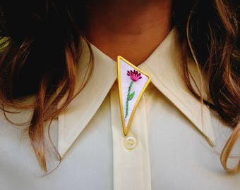 Embroidered Pin. A Single Flower