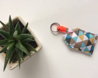 Key House green and neon orange triangles