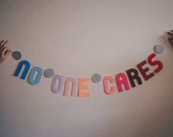 NO ONE CARES Banner