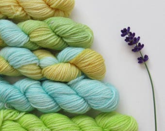 Set of five 10g mini skeins in blues, yellows and greens on merino wool and nylon blend knitting yarn